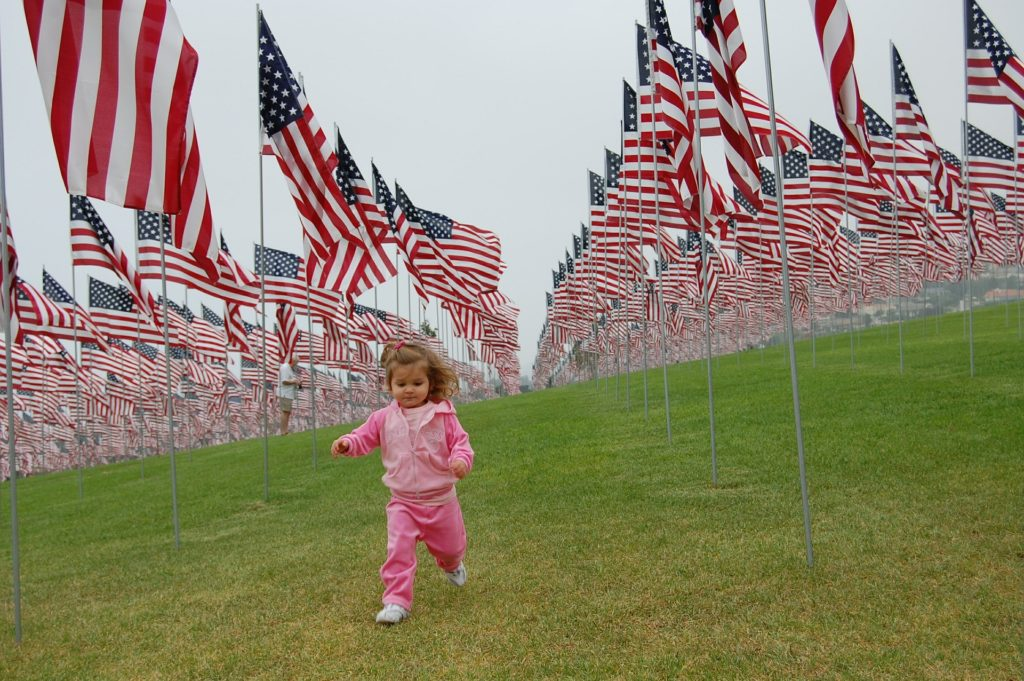 American flags and child